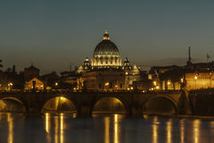 Angelo bridge and St. Peter's Basilica at dusk Stock Photos