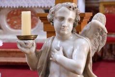 Angelo sull'altare in chiesa francescana dei frati secondari in Ragusa Immagini Stock