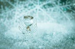 Angelo vitroso e fiocco di neve bianco semplice fotografia stock