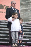 Angelo Zomegnan with Ivan Basso's children. Angelo Zomegnan, the director of Giro d'Italia, with Ivan Basso's children in the Verona Arena, in the day of Basso's Royalty Free Stock Photo