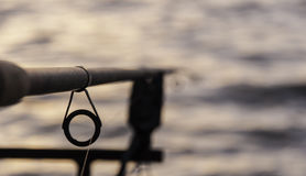 Angelrute bei Sonnenuntergang Lizenzfreies Stockfoto