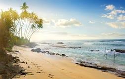 Angelruten im Ozean Stockbilder