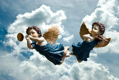 Angels. Two angels singing on a sky background Stock Images