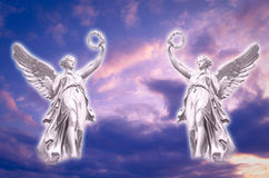 Angels. Two angels archangels over beautiful sky stock images