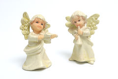 Angels. Two figures of angles playing instruments over white Stock Images