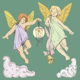 Angels. Fly. Cupids hold bell and lantern Royalty Free Stock Images