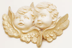 Angels. Two golden little angels, concept stock photography
