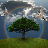 Angels above green tree. Dramatic clouds and rainbow. 3D rendering Stock Photography