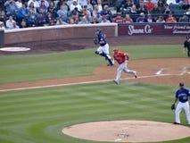 Angels batter Albert Pujols runs with Rockies catcher towards fi Stock Photo