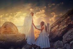Angels on the beach Stock Photos