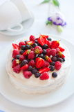 Angels cake with berries Stock Photography