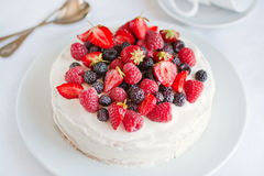 Angels cake with berries Royalty Free Stock Image