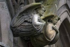 Angels of stone. Angels carved from stone on an old irish church Royalty Free Stock Photo