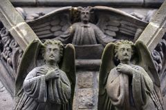 Stone angels. Angels carved from stone on an old irish church Stock Images