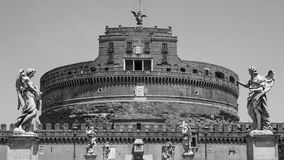 The angels of Castel Sant'Angelo. A view of Castel Sant,Angelo, or Mausoleum of Hadrian, from Sant'Angelo bridge in Rome Stock Images