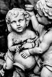 Angels cherub. Garden statues black and white Royalty Free Stock Photo
