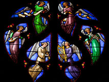 Angels choir. Stained glass window depicting an Angels choir, in the cathedral of Brussels Stock Photography