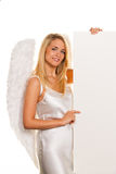 Angels for Christmas with an empty table for Stock Image