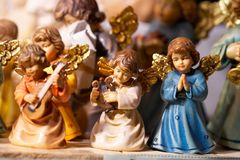 Angels in Christmas shop - Engel und Krippenfiguren Royalty Free Stock Image