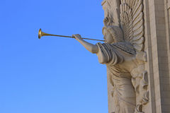 Angels in the city. Handcarved angel sculture playing the trumpet Royalty Free Stock Images