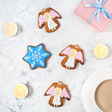 Angels cookies on Christmas eve royalty free stock photos