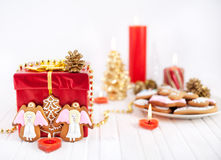Angels cookies and red present at Christmas royalty free stock photos
