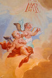 Angels fresco from ceiling of chapel in Saint Anton palace by Anton Schmidt from years 1750 - 1752. Royalty Free Stock Image