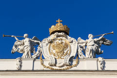 Angels glorifying Austrian insignia of power Royalty Free Stock Photography