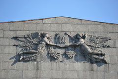 Angels of granite on the facade of the house Royalty Free Stock Photo