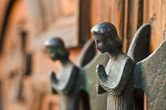 Angels. Handles detail of wooden church door Stock Image