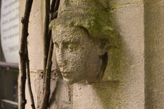 Angel's head decoration on the old wall of the church, The Garden museum in London Stock Photo