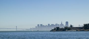Angels Island with San Francisco Skyline. The east side of Angels Island is in the foreground and the San Francisco Skyline and Bay Bridge are in the background stock images