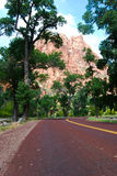 Angels Landing mountain peaking through trees. Mt. Zion National Park, St. George UT Royalty Free Stock Photography