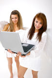 Angels With Laptop. Two angels using a lap top computer Royalty Free Stock Photos