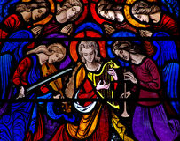 Angels making music in stained glass. A photo of Angels making music in stained glass stock image
