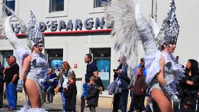 Angels parade at the carnival of Limoux in Aude,  France. Angels parade at the french carnival of Limoux in Aude, Occitania in the southern of France stock video