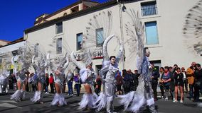 Angels parade at the carnival of Limoux in Aude,  France. Angels parade at the french carnival of Limoux in Aude, Occitania in the southern of France stock video footage
