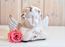 Angels and pink rose Royalty Free Stock Photo