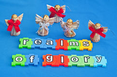Angels from the realms of glory. 'Angels from the realms of glory' shown in  in white lower case text on colorful jigsaw style pieces  with winged angels  on a Royalty Free Stock Photos