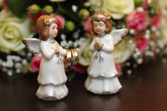Angels rings flowers. Angels and wedding rings Stock Image