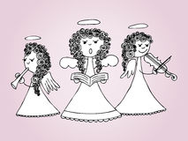 Angels singing and playing carols Stock Image