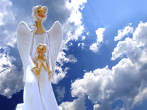 Angels in the Sky. Beautiful porcelain angels on blue sky background Stock Photography