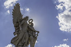 Angels. Statue with clouds on sunny day protected us stock photo