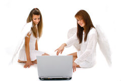 Angels Teaming Together. Two angels working on a computer to keep track of their assignments Royalty Free Stock Photos