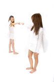 Angels Touch. Two winged angels reaching out to one another and touching fingers Stock Image
