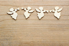Angels with trumpets on wooden background, copy space Stock Photo