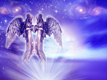 Angels. Two angels over purple divine sky Stock Photography