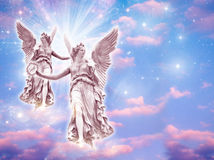Angels. Two angels wit rays of light Royalty Free Stock Photo