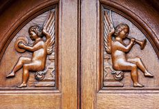 Angels on wooden door Stock Photo
