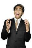 Angenehm überraschter junger indischer Geschäftsmann Stockbilder